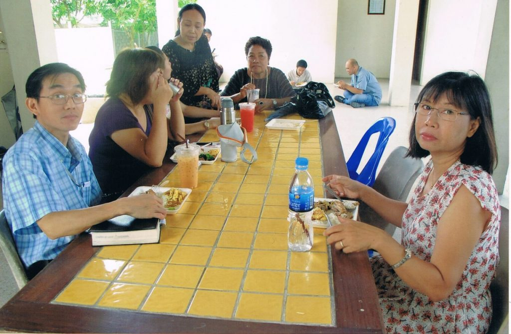 Watcharapon Church of Christ, Bangkok, Thailand. Members at Watcharapon eating lunch with Penjai Thitathan (right), the wife of our indigenous missionary in Thailand, Patinya Thitathan. Pitinya is also responsible for mission efforts in Laos